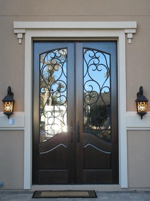 двери входные металлические со стеклом и ковкой цена