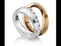 f955f19bb8c1 Обручальные кольца из золота двух цветов ассиметричной формы с бриллиантами  в женском кольце