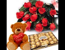 11 красных роз плюшевый мишка и конфеты Ферреро Роше набор Праздничный