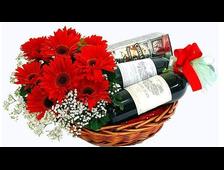 Герберы красные и вино