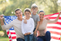 portrait-of-beautiful-modern-american-family-with-usa-flag-outdoors.jpg