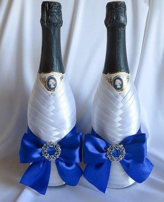 Украшение шампанского лентами на свадьбу