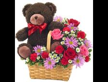 Корзина цветов и плюшевый мишка