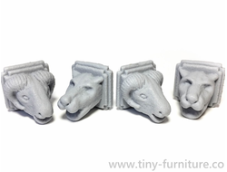 Stone animal heads (unpainted)
