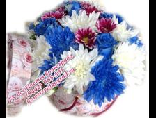 Цветы в шляпной коробке с ручками